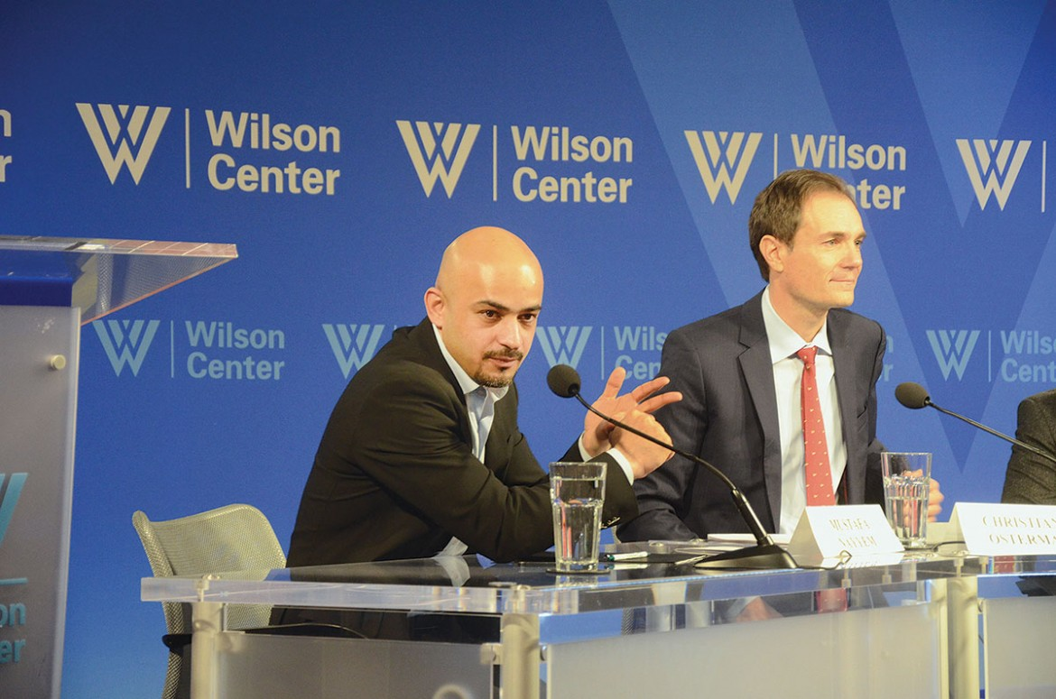 "Mustafa Nayyem, the recipient of the 2014 Ion Ratiu Democracy Award (left), answers questions after his presentation about ""Ukrainian Democracy after the Maidan: Threats and Opportunities."" Seated next to him is Christian Osterman, director of the Wilson Center's Global Europe Program."