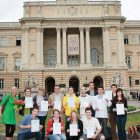 "Standing before Lviv National University, students from the University of Alberta's ""Ukrainian Through Its Living Culture"" program of 2011 show their diplomas."