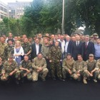 "The photo above was posted on Sen. John Mc Cain's Facebook page with this notation: ""Honored to visit brave volunteers stationed at Dnipro-1 Territorial Defense Battalion in Dnipropetrovsk, Ukraine & meet with Ukrainian Pres Petro Poroshenko & PM Arseniy Yatsenyuk this weekend. I will always stand w/ free Ukraine!"""