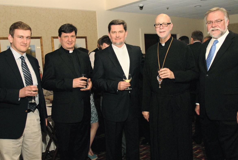 At the anniversary dinner (from left) are: Ostap Nalysnyk, Father Bohdan Nalysnyk, jubilarian Father Yaroslav Nalysnyk, Bishop Paul Chomnycky and Walter Lupan.