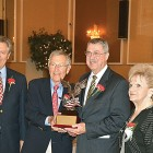 At the Captive Nations Dinner, American Nationalities Movement President Judge Ralph Perk Jr. (left), Sen. George Voinovich (second from left) and Retired Nationalities Movement President Irene Morrow (right) present Andrew Fedynsky with the 2015 Freedom Award.