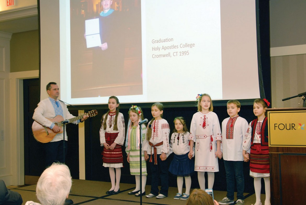 The youngest parishioners offer their greetings in the form of poetry and song.