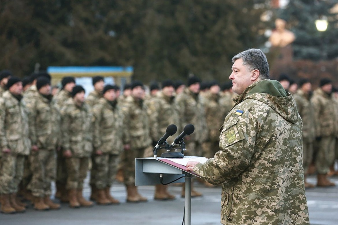 President Petro Poroshenko on January 11 with soldiers of an artillery brigade during a working visit to Ternopil. Seventy percent of Ukrainians polled disapprove of his government's handling of the war in the Donbas.