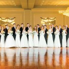 Debutantes of the American Ukrainian Youth Association Mykola Pavlushkov Branch in Chicago with their escorts.