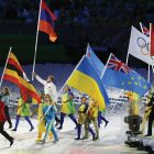 Saber fencer Olha Kharlan serves as flag-bearer for Ukraine during the closing ceremonies of the 2016 Rio Olympics.
