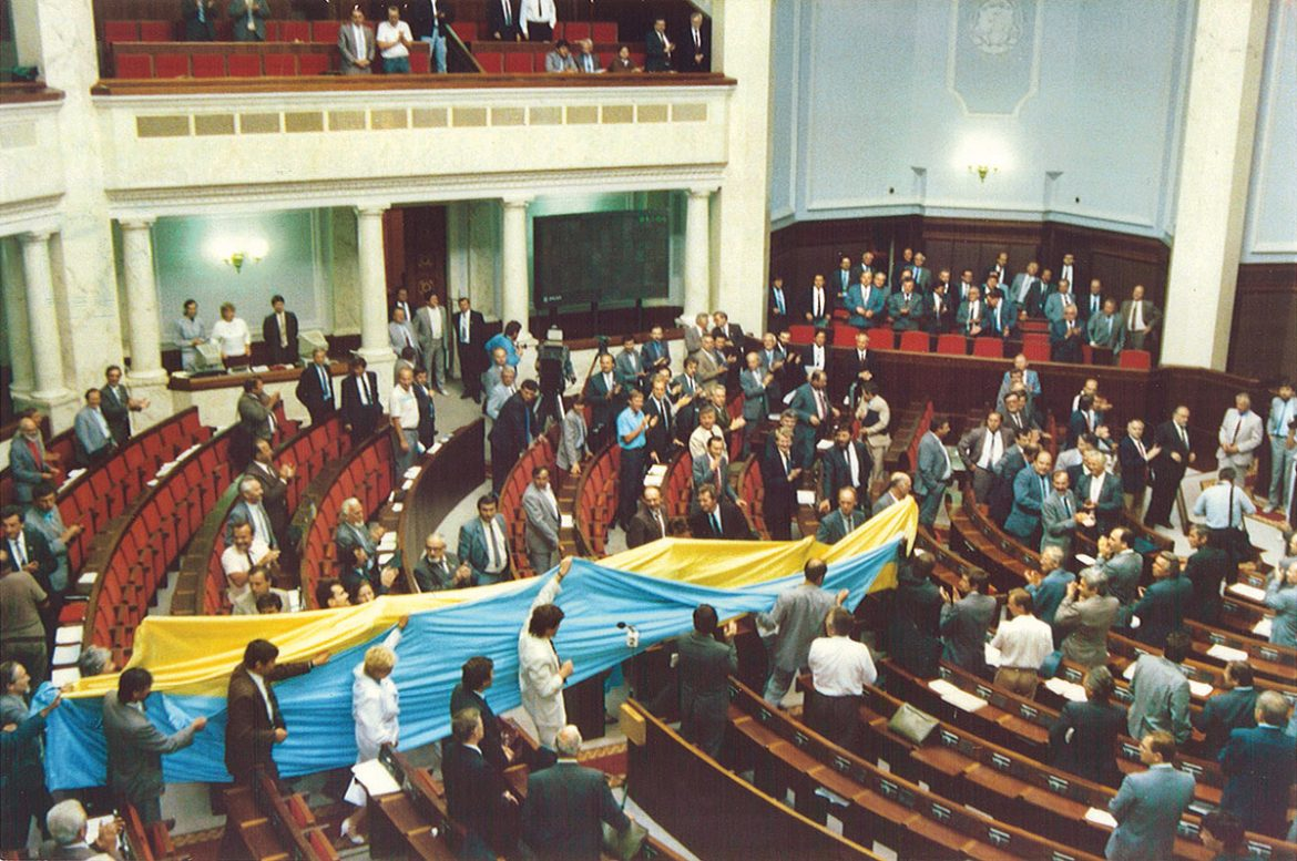 August 24, 1991: The scene inside the Verkhovna Rada after the vote for Ukraine's independence. Members of the democratic bloc carry in a huge Ukrainian flag, which had been draped over one of the tanks protecting the Russian Parliament building at the time of the attempted coup in the Soviet Union.