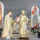 During the consecration ceremonies of the University Church of the Holy Wisdom of God, Patriarch Sviatoslav presents a patriarchal honor to the church's architect, Ivan Bereznicki.