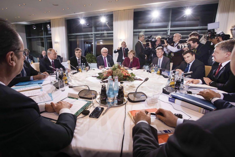 German Chancellor Angela Merkel (center) hosts talks in Berlin with Russian Presidents Vladimir Putin of Russia, Petro Poroshenko of Ukraine and Francois Hollande of France regarding the war in Ukraine.