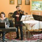 The music trio of (from left) Galyna Kryvanych, Liubomyr Senyshyn and Lillian-Terri Dahlenburg performs at Christ the King Parish's patronal feast day.