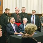 The signing on September 28 of the historic agreement marking the relocation of the Sheptytsky Institute to Toronto. MASIF President Andrew Hladyshevsky and University of St. Michael's College President David Mulroney sign the Memorandum of Agreement. Looking on are: Paul Grod, Father Andriy Chirovsky, Father Peter Galadza, Bishop Bryan Bayda, Patriarch Sviatoslav, Cardinal Thomas Collins, Bishop Stephen Chmilar, USMC Faculty of Theology Dean James Ginther, USMC Chief Administrative Officer Effie Slapcinar and Former Dean of Theology Father Mario D'Souza.