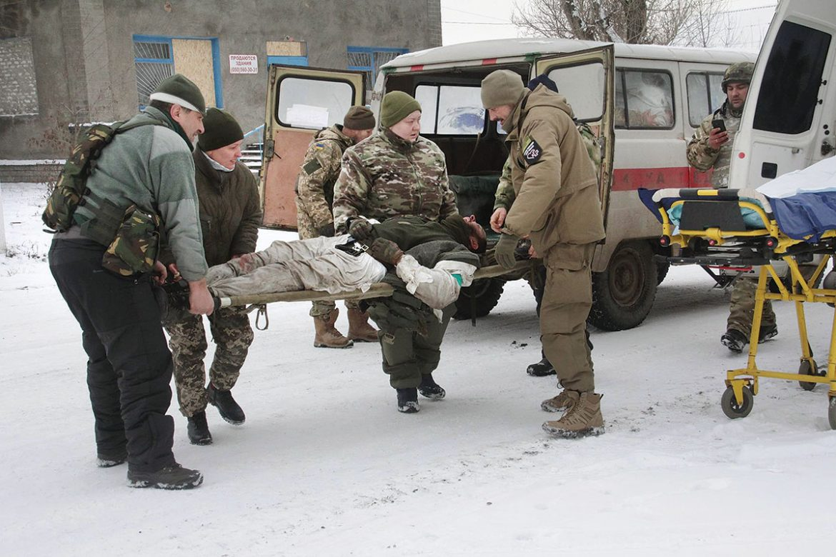 Wounded Ukrainians soldiers get evacuated some 800 meters from the frontline near Luhanske, a village situated along what is known as the Rostov-on-Don highway, not far from occupied Debaltseve, on December 18.