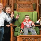 Mykola sits in the chair of the House of Commons speaker, giving the trident victory salute. With him (from left) are: MP Borys Wrzesnewskyj, Victor Hetmanczuk, Alla Nyzhnykovska and Krystina Waler.