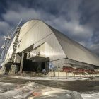 The new confinement structure for the Chornobyl plant, seen on November 14, as the arch sliding began. It took two weeks for the structure to be moved into place.