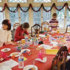 Young workshop participants making traditional paper doves, vertep stars and St. Nicholas ornaments.