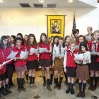 Plast scouts sing the Bethlehem Peace Light song.