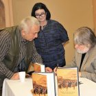 Dr. Bohdan Kordan signs a copy of his new book for an attendee, as Marijka Stadnyk, vice-president of the Toronto branch of the Ukrainian Canadian Congress, looks on.