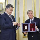 President Petro Poroshenko awards the Order of Freedom the Order of Prince Yaroslav to the Wise to Sen. Lindsey Graham.