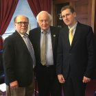 Rep. Sander Levin is flanked by Borys Potapenko (left) and Ostap Kryvdyk.