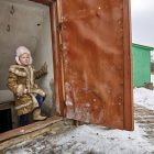 On February 13, when there seemed to be a pause in the shelling and fighting, 6-year-old Sasha, carefully ascends the steep steps that lead outside of the cellar of her home, about 15 kilometers from the contact line in Toretsk, Donetsk region of Ukraine.