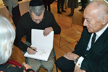 "Yohanan Petrovsky-Shtern signs a copy of ""Jews and Ukrainians, a Millennium of Co-Existence"" for Dr. Vasyl Truchly."