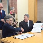 Holocaust Memorial Museum Collections Director Michael Grunberger (left) and Ukrainian Museum-Archives Director Andrew Fedynsky congratulate each other after signing a cooperation agreement in Washington to digitize the Cleveland-based Museum-Archives' post-World War II collection of documents and stories about non-Jewish victims of Nazism.