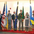 The color guard prior to the U.S. national anthem sung by Anya Kosachevich (second from right). From left are: Myron Bytz, Eugene Mandzy, Stefan Krysyna, Ihor Rudko, Pavlo Pencak, Alexandra Soltys and Chris Bytz.