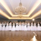 The 15 debutantes are presented to the crowd.