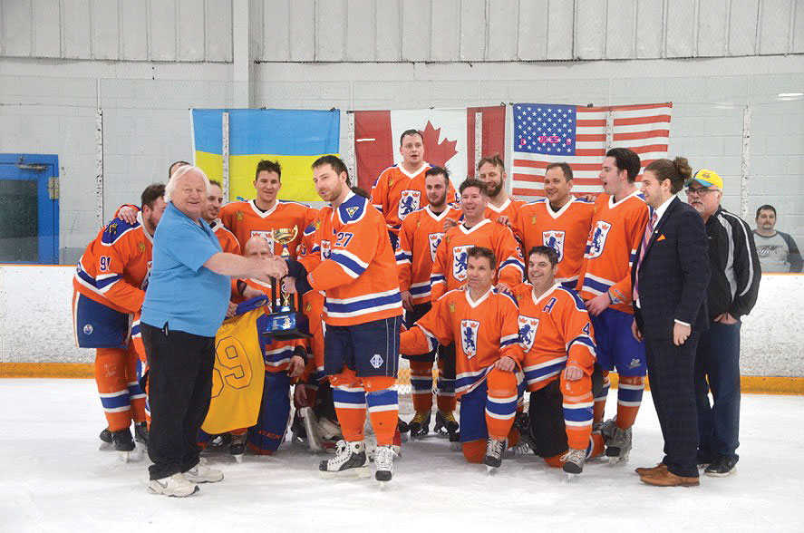 The Edmonton Lions receive the championship trophy of the 2017 Alexander Cup.