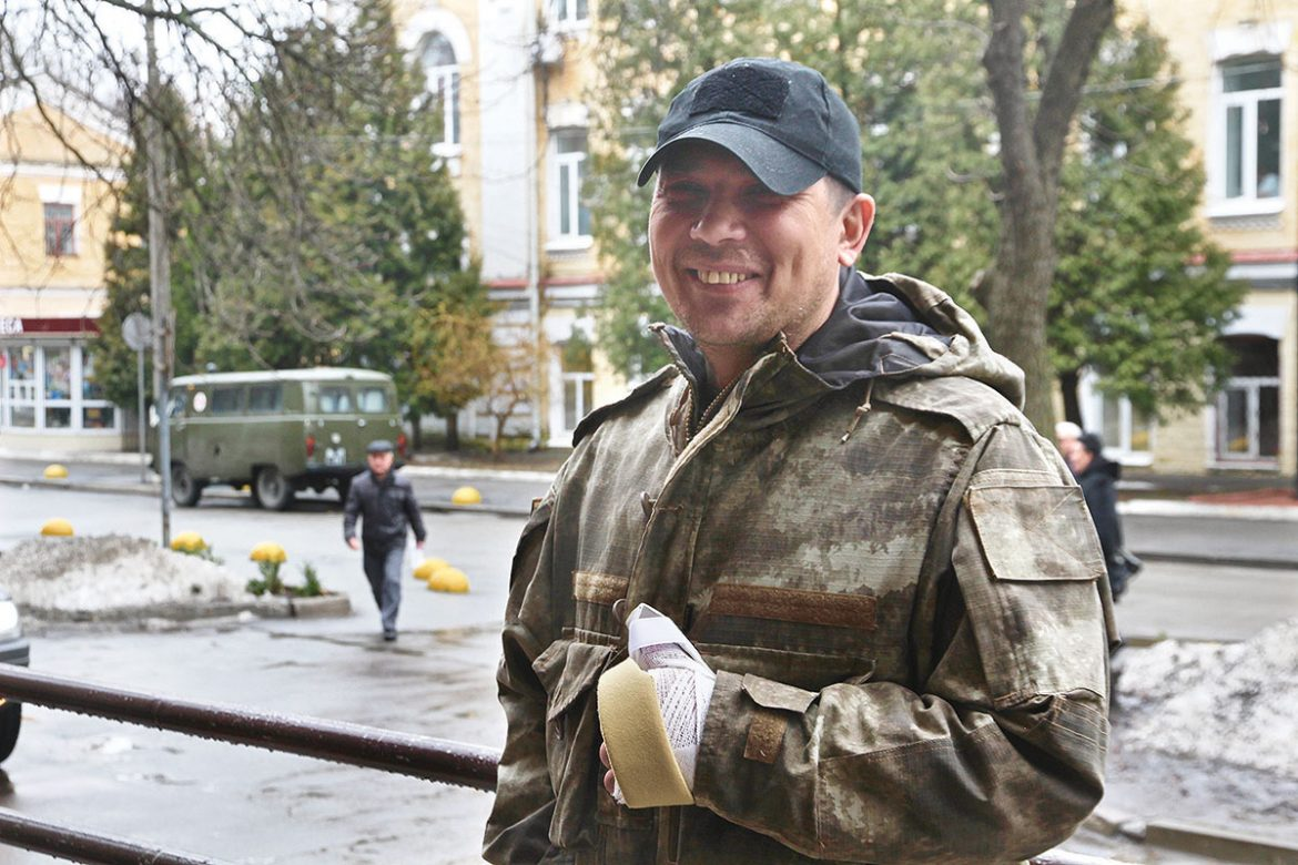 Serhiy Vovchuk of the Kyivska Rus' 11th Battalion smiles after his left hand was operated on February 27 to repair tendons so that functionality could be returned to his thumb. He was wounded by gunfire while fighting near the Luhansk Oblast town of Popasna in the summer of 2016.