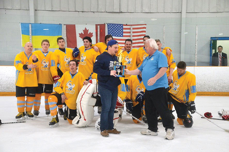 Third-place winners Toronto Kozaks receive their trophy.