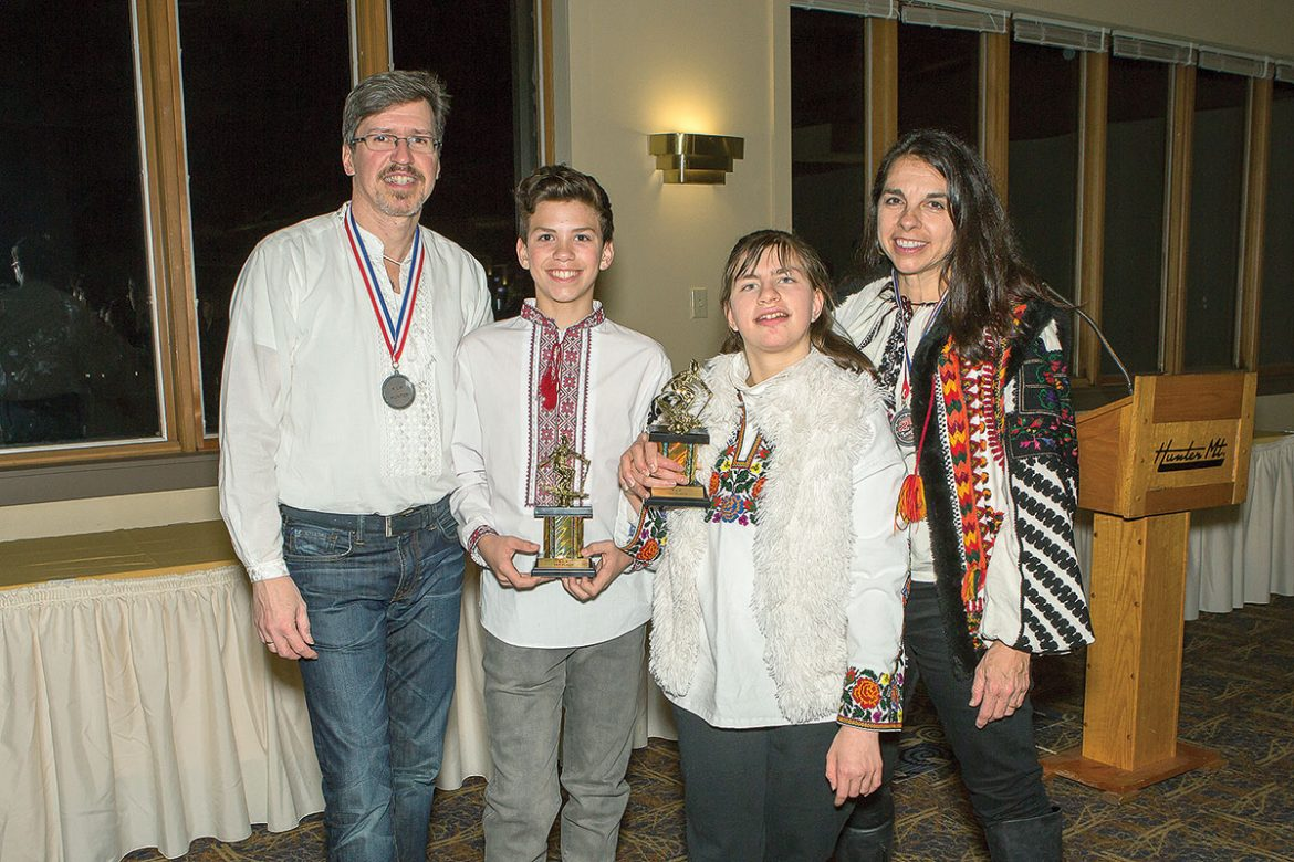 All the members of the Wojcickyj family, (from left) Stefan, Marko, Adriana and Natalia, competed in the races. Marko received the trophy for boys age 12-14; Adriana received a special award for bi-skiing.