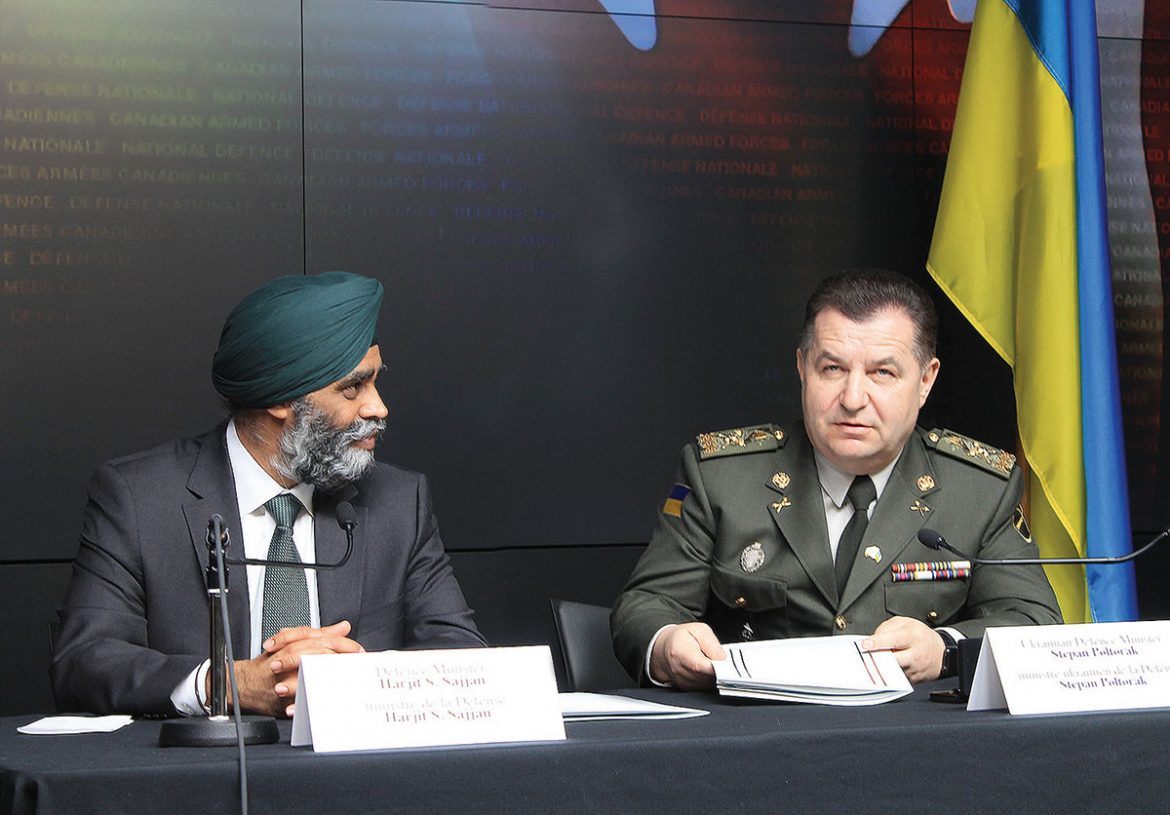 Canadian Defense Minister Harjit Sajjan and Ukrainian Defense Minister Stepan Poltorak sign the Canada-Ukraine Defense Cooperation Agreement on April 3.