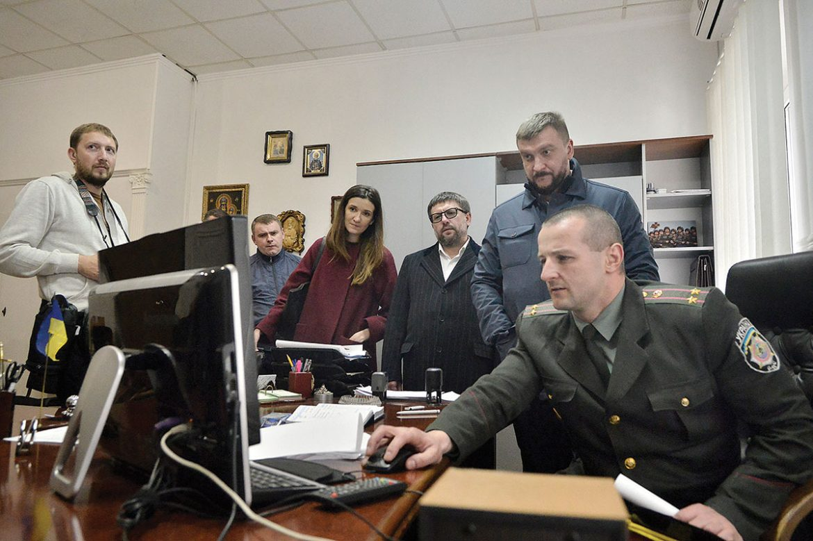 A deputy warden (seated) at the Lukyanivska Prison gives a presentation via computer to Justice Minister Pavlo Petrenko (background) and (next to him) Deputy Justice Minister Denys Chernyshov on April 18 in Kyiv.