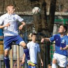 Dynamo Kyiv's Yaroslav Nadolskyi (left) connects with the ball in midair as Torontonian Daniel Nimilovitch closes in during a friendly match on April 3 in Kyiv between Dynamo U.S.A.-Canada and the under-16 team of Dynamo Kyiv.