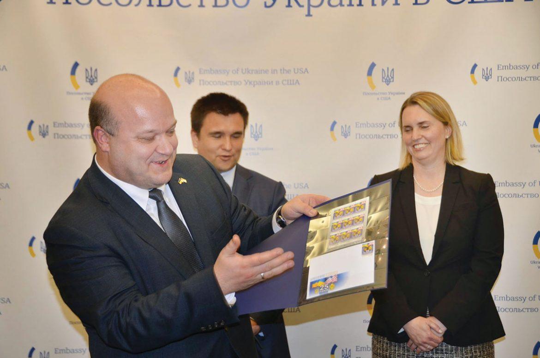 Ambassador Valeriy Chaly presents the Ukrainian postage stamp marking the 25th anniversary of Ukraine-U.S. relations. Looking on are Ukraine's Foreign Affairs Minister Pavlo Klimkin and U.S. Deputy Assistant Secretary of State Bridget Brink.