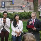 Boston Holodomor Remembrance Committee Chairman Paul Thomas Rabchenuk reads survivor testimony at Boston's fourth annual Walk Against Genocide. On the left are Maria Carine Boggis, a Rwanda survivor, and Sokum Chum, a Cambodian survivor.