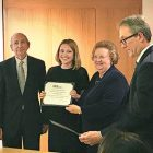 """Iuliia Iarmolenko (second from left) receives a certificate of appreciation for """"exceptional dedication in covering U.S.-Ukrainian relations."""" The award is presented by Nadia K. McConnell (president, U.S.-Ukraine Foundation); Ambassador Roman Popadiuk (left) and Adrian Karmazyn look on."""