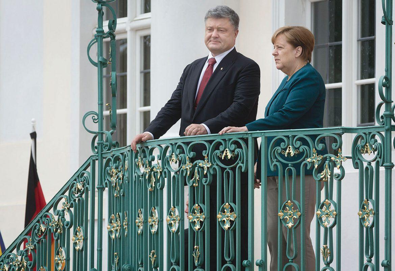 President Petro Poroshenko and German Chancellor Angela Merkel during their meeting in the village of Meseberg, north of Berlin, on May 20.