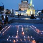 People lay candles in Kyiv on May 18 to commemorate the Soviet-era mass deportation of Crimean Tatars.