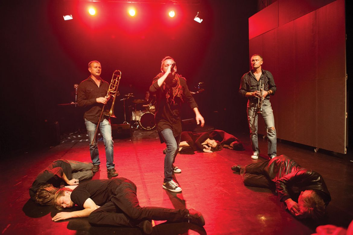 """Serhiy Zhadan (center) and the Dogs in Yara Arts Group's production """"1917-2017: Tychyna, Zhadan & the Dogs."""""""