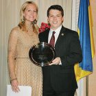 Rep. Brendan F. Boyle receives the Distinguished Friend of Ukraine award from Alexa Chopivsky, executive director of the American Center for a European Ukraine.