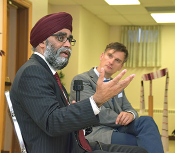 Canada's defense minister, Harjit Sajjan, with Yaroslav Baran, president of the Ottawa branch of the Ukrainian Canadian Congress, who served as moderator of the town hall meeting.