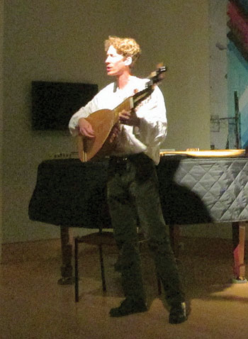 "Jurij Fedynskyj plays the torban during ""Out of the Studio: Process and Practice."""