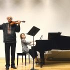 Oleh Krysa and Irina Lupines dramatically conclude their rendition of Johannes Brahms' Sonata for Violin and Piano No. 3 at The Washington Group Cultural Fund's last concert of the 2016-2017 music series at the Lyceum in Old Town Alexandria, Va.
