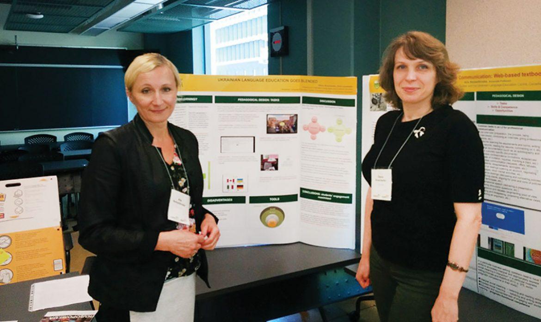 Alla Nedashkivska (left) and Olena Sivachenko showcase their posters.