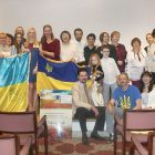 United Help Ukraine members, guests and donors gather following the April 22 classical piano concert to benefit Ukraine's wounded soldiers.