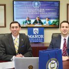 Manor College's President Jonathan Peri and Vice-President of Academic Affairs Stephen Greico virtually sign an agreement with Vasyl Stefanyk Precarpathian National University in Ukraine.