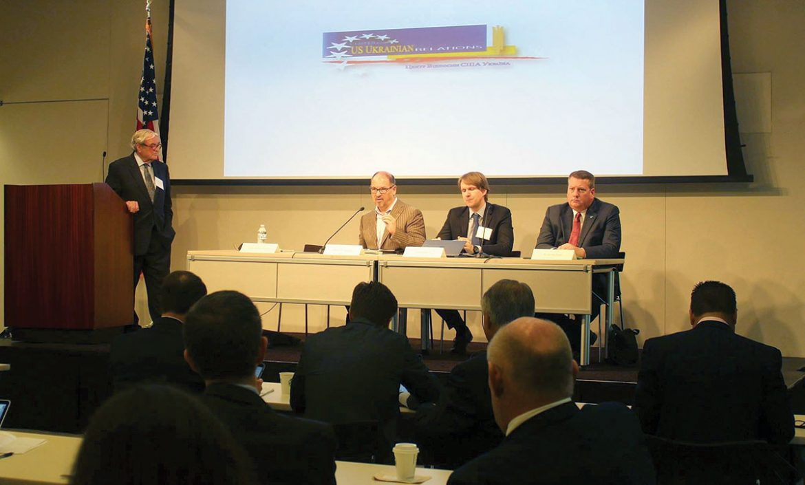 Ambassador William Miller chairs the panel discussion on fiscal and monetary policy among independent consultants (from left) Adrian Karatnycky, Aleks Mehrle and Brian Mefford.