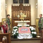 "Plast scouts stand guard at the ""Plashchanytsia"" (Holy Shroud) at Holy Protection of the Mother of God Church in Mount Kisco, N.Y. From left are: Larissa Pawliczko, Mykola Pawliczko and Mark Myskiw."