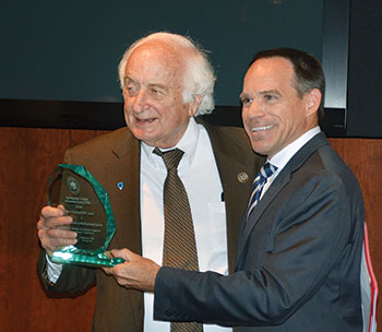 Congressman Sander Levin (D-Mich.), an organizer and active member of the Congressional Ukrainian Caucus, accepts the Friend of UNIS Award from the director of the Ukrainian National Information Service, Michael Sawkiw.